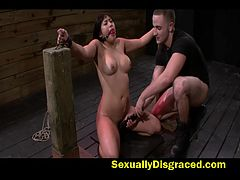 Mia Li bound and chained on floor while rubbed with a vibrator